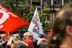 Strabourg en colere史特拉斯堡恼怒对抗议旗子 免版税库存照片