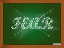 Strach krzyżujący out na chalkboard Obrazy Stock