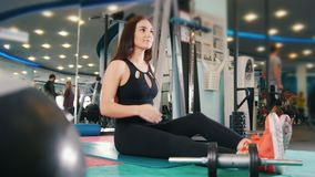Straching in the gym - young women exercising healthy lifestyle in fitness studio - slider shot stock video