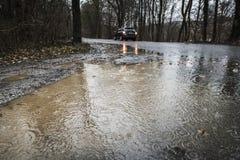 Strada bagnata in pioggia persistente Immagine Stock Libera da Diritti