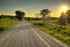 Strada campestre al tramonto Immagine Stock Libera da Diritti