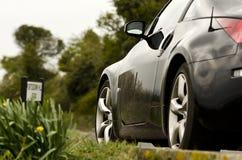 Strada campestre dell'automobile sportiva dei Nissan Fotografia Stock Libera da Diritti