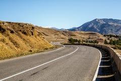 Strada campestre nelle montagne Fotografia Stock