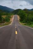 Strada collinosa lunga Fotografia Stock