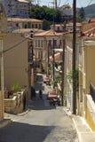 Strada collinosa nella città di Samos - isola di Samos Immagini Stock Libere da Diritti