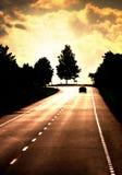 Strada con l'automobile sola Fotografie Stock