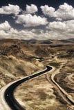 Strada curva con il cielo stupefacente Fotografia Stock Libera da Diritti