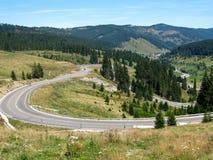 Strada curva della montagna Fotografie Stock Libere da Diritti