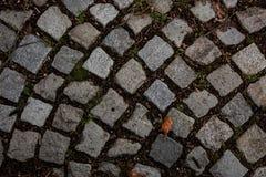 Strada dalla pietra per lastricati, pietre di struttura, fondo di vecchie pietre Vecchia pavimentazione Fotografia Stock