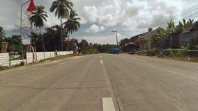 Strada del villaggio Moto sulla motocicletta filippine Isola di Bohol archivi video