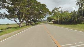 Strada del villaggio Moto sulla motocicletta filippine Isola di Bohol video d archivio