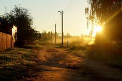 Strada della campagna con la luce del sole Immagini Stock Libere da Diritti