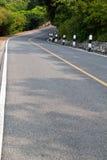 Strada della curva in valle Immagini Stock Libere da Diritti
