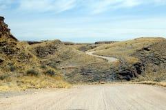 Strada della ghiaia in Namibia Immagine Stock