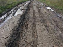 strada della pioggia della terra del paese Immagini Stock