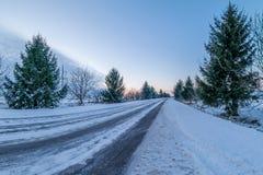 Strada di inverno al tramonto Immagine Stock Libera da Diritti