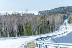 Strada di inverno in foresta siberiana Fotografia Stock Libera da Diritti