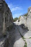 Strada di pietra alla città della caverna Fotografie Stock Libere da Diritti