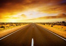 Strada di tramonto Immagini Stock