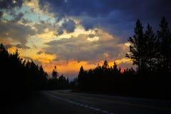 Strada di tramonto a Yellowstone Fotografia Stock Libera da Diritti