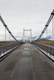 Strada diritta e ponte metallico in Islanda Fotografia Stock