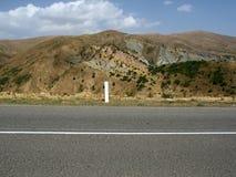Strada e collina Fotografie Stock Libere da Diritti