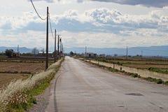 Strada e montagne della campagna Fotografia Stock