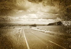 Strada e paesaggio piano nella seppia Fotografie Stock Libere da Diritti