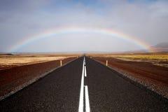 Strada e Rainbow Immagini Stock