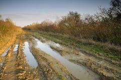Strada fangosa immagine stock