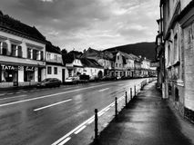Strada Lungă (The long street) in Brasov, Romania. Black and white filter applied. Brașov is a city in Romania and the administrative centre of Brașov Stock Photography