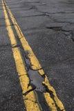 Strada necessitante la riparazione Fotografia Stock