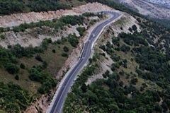 Strada nelle montagne Fotografia Stock
