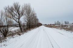 Strada nevicata all'azienda agricola Immagine Stock Libera da Diritti