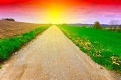 Strada non asfaltata al tramonto Fotografia Stock Libera da Diritti