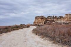 Strada non asfaltata di bobina nei calanchi della Castle Rock fotografia stock
