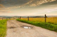 Strada non asfaltata nelle colline Fotografia Stock