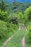 Strada non asfaltata nelle montagne di Balcani Immagine Stock Libera da Diritti