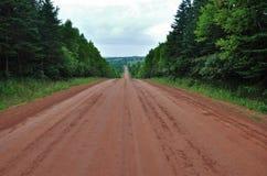 Strada non asfaltata rossa Immagini Stock