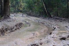 strada piena del fango Fotografia Stock