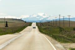Strada principale di rotolamento nel Montana di nord-ovest Fotografia Stock Libera da Diritti