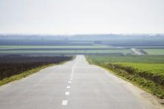 Strada rurale lungamente vuota Fotografia Stock