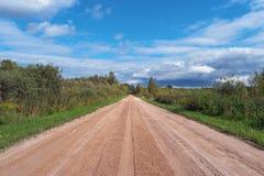 Strada scenica della ghiaia in strada campestre rurale della foresta Fotografia Stock
