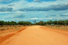 Strada sola di entroterra del deserto, Australia Fotografia Stock