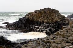 Strada soprelevata esagonale di Giants delle rocce, Irlanda del Nord Fotografia Stock
