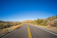 Strada sterile della strada principale del deserto Fotografie Stock