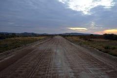 Strada vuota all'alba Fotografia Stock Libera da Diritti