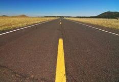 Strada vuota della strada principale lungo il grande canyon Fotografie Stock Libere da Diritti