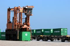 Straddle carrier shipping container Stock Photography