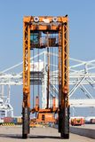 Straddle carrier shipping container Royalty Free Stock Photos